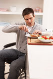Disabled Man Making Sandwich In Kitchen Royalty Free Stock Photography