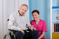 Disabled man and nurse in a hospice stock image