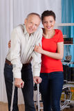 Disabled man with nurse Royalty Free Stock Image