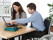 Disabled man in the office Royalty Free Stock Image