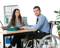 Disabled man in the office Stock Photos