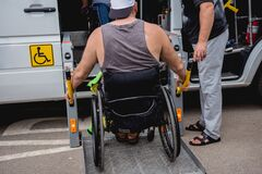 Free Disabled Man On Wheelchair Using Accessible Vehicle With Lift Mechanism. Stock Photography - 194881392