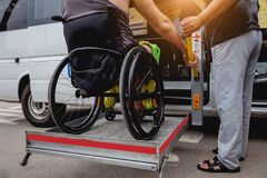 Free Disabled Man On Wheelchair Using Accessible Vehicle With Lift Mechanism. Royalty Free Stock Image - 199251376