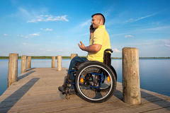 Disabled man outside in summer Royalty Free Stock Photo