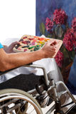 Disabled man painting picture Royalty Free Stock Image
