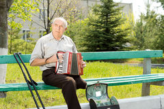 Disabled man playing the accordion Royalty Free Stock Photography
