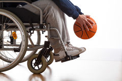 Disabled man playing basketball Royalty Free Stock Image