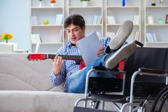 The disabled man playing guitar at home Stock Photography