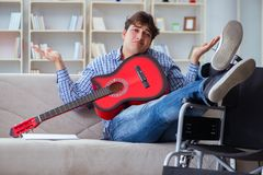 The disabled man playing guitar at home Royalty Free Stock Photos