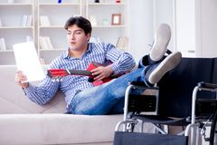 The disabled man playing guitar at home Royalty Free Stock Image