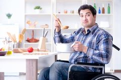 The disabled man preparing soup at kitchen Stock Image