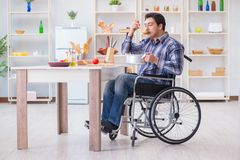 The disabled man preparing soup at kitchen Royalty Free Stock Images
