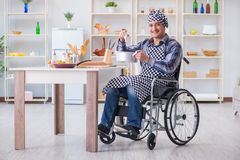 The disabled man preparing soup at kitchen Royalty Free Stock Photography