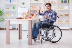 The disabled man preparing soup at kitchen Stock Photos