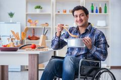 The disabled man preparing soup at kitchen Stock Images