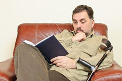 Disabled man reading Stock Images