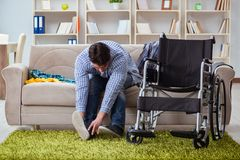 The disabled man recovering at home. Disabled man recovering at home Stock Photo