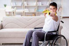The disabled man recovering from injury at home Royalty Free Stock Photos