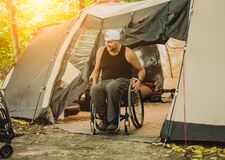 Free Disabled Man Resting In A Campsite With Friends. Wheelchair In The Forest Stock Photos - 172204643