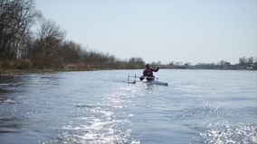 Disabled man rowing on the river in a canoe. Rowing, canoeing, paddling. Training. Kayaking. paraolympic sport. Disabled Athlete rowing on the river in a canoe stock footage