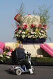 Disabled man in scoot mobiel is watching the Bloemencorso Bollenstreek Stock Image