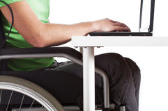 Disabled man sitting at a desk Royalty Free Stock Photography