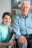 Disabled man and social welfare worker Royalty Free Stock Photography