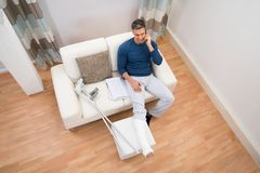 Disabled man talking on cellphone Royalty Free Stock Images