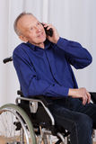 Disabled man talking on the phone Royalty Free Stock Images