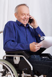 Disabled man talking on phone Stock Image