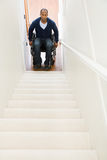 Disabled man trapped at bottom of stairs Stock Image