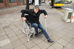 Disabled man trying to walk Stock Image