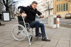 Disabled man trying to walk Royalty Free Stock Images