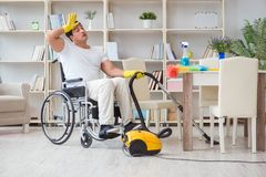 The disabled man with vacuum cleaner at home Royalty Free Stock Images