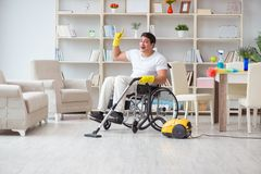 The disabled man with vacuum cleaner at home Royalty Free Stock Photo