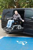 Disabled man on wheelchair lift. Disabled man on wheelchair car lift stock photography