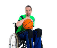 Disabled man in a wheelchair is doing sport with ball Stock Photos