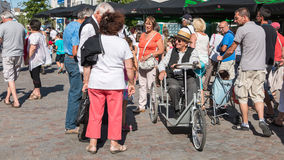 Disabled man in a wheelchair from the early 20th century. Challans, France - August 11, 2016 : event Once Challans Autrefois Challans organized by the city and Royalty Free Stock Photo