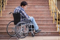 The disabled man on wheelchair having trouble with stairs. Disabled man on wheelchair having trouble with stairs Stock Images