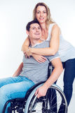 Disabled man in wheelchair and his wife Royalty Free Stock Photography