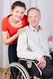 Disabled man on wheelchair and nurse Stock Photography