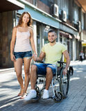Disabled man in wheelchair outdoor Royalty Free Stock Photos
