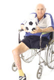 Disabled man in wheelchair with soccer ball royalty free stock photos