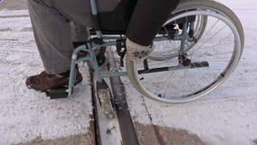 Disabled man on wheelchair stuck on railway stock footage