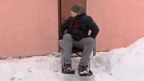 Disabled man on wheelchair talking near the door stock video footage