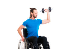 Disabled man in wheelchair train with bar-bell Stock Photos