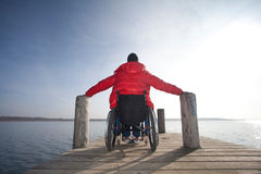 Disabled man in wheelchair Stock Images