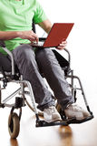 Disabled man working on laptop Royalty Free Stock Photos