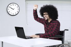 Disabled man working with laptop in workplace Royalty Free Stock Photography
