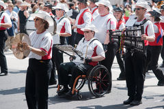Disabled member of marching band Stock Photos